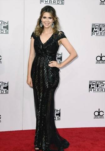Actress-Carly-Steel-wearing-CRISTALLINI-on-the-red-carpet-at-the-American-Music-Awards.-335x480